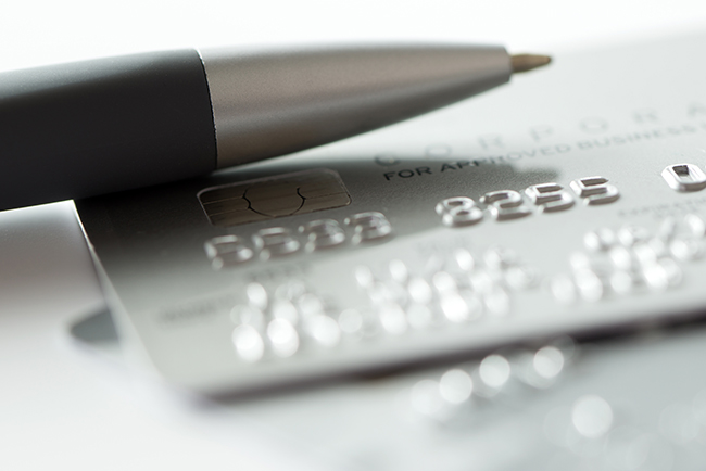 An image of a silver pen and a credit card.
